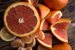 Orange mandarin red on wood Stock Photography