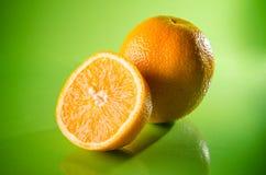 Orange, mandarin or tangerine fruit  on green background, horizontal shot. Picture presents orange, mandarin or tangerine fruit  on green background, horizontal Royalty Free Stock Photos
