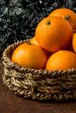 Orange mandarines. In basket on wooden table Royalty Free Stock Photo