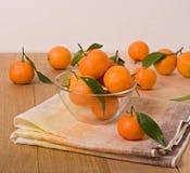 Orange mandarins in a glass bowl Stock Image