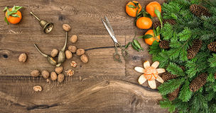 Orange mandarins, walnuts and antique accessories Royalty Free Stock Photos