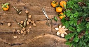 Orange mandarins walnuts antique accessories Christmas tree Royalty Free Stock Images