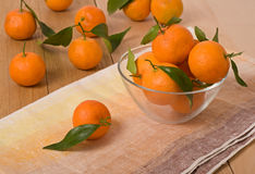 Orange mandarins on wooden table Royalty Free Stock Photos