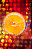 Orange  with many water drops on the abstract background Stock Images