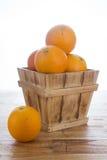 Orange. Many orange in wood basket stock image