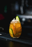 Orange margareta fresh Cocktail on a table in bar. Orange margareta fresh Cocktail with cucumber on a table in bar Royalty Free Stock Images