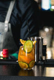 Orange margareta fresh Cocktail on a table in bar. Orange margareta fresh Cocktail  whith orange and cucumber on a top on a table in a bar Royalty Free Stock Photo