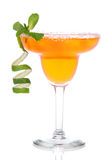 Orange Margarita cocktail with mint and lime spiral in chilled s stock photography