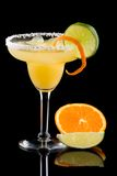 Orange Margarita  - Most popular cocktails series. Orange Margarita in chilled glass over black background on reflection surface, garnished with fresh lime and Royalty Free Stock Photos