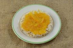 Orange marmalade in brown rice cake Royalty Free Stock Image