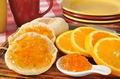 Orange marmalade on an English muffin Royalty Free Stock Photos