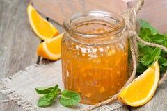 Orange marmalade in a glass jar, close-up Stock Photo