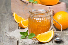 Orange marmalade in a glass jar, horizontal Stock Photography