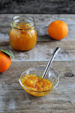 Orange marmalade in a jar with spoon Stock Images