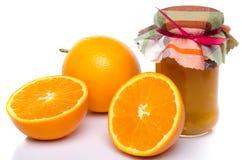 Orange marmalade with oranges Stock Images