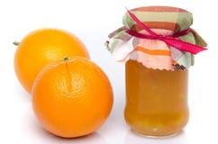 Orange marmalade with oranges Royalty Free Stock Photo