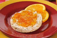Orange marmalade on a rice cake Stock Photo