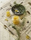 Orange marmalade in small glass jars with rosemary, selective focus Stock Photography
