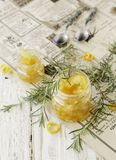 Orange marmalade in small glass jars with rosemary, selective focus Stock Image