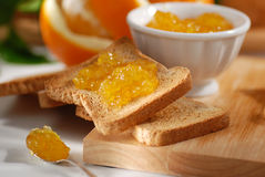 Orange marmalade on toast Stock Images