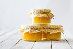 Orange marmalade on white table Royalty Free Stock Images
