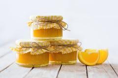 Orange marmalade on white table Royalty Free Stock Photo