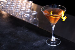 Orange Martini. An orange martini on a bar in a bar royalty free stock images