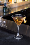 Orange Martini. An orange martini on a bar in a bar stock image
