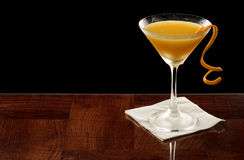 Orange martini garnished with a twist Royalty Free Stock Photos