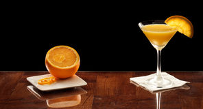 Orange martini with an orange slice Royalty Free Stock Photography