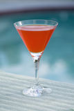 Orange Martini at the Pool. Orange Martini by the Pool Royalty Free Stock Photo