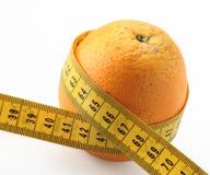 Orange and measure tape centimeters. Orange citruis fruit measure tape centimeteres waist diet Stock Image