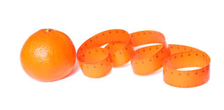 Orange and measuring tape Stock Photography