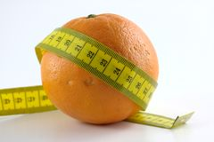 Orange with measuring tape. A orange with measuring tape on a white background Stock Image