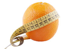 Orange and measuring tape Royalty Free Stock Images