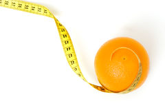 Orange with measuring tape Royalty Free Stock Photo