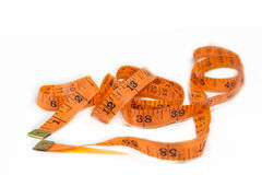 Orange measuring tape on white background. Royalty Free Stock Photos