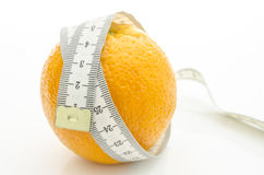 Orange with measuring tape wrapped around it Royalty Free Stock Image