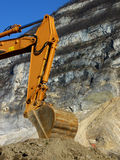 Orange mechanical digger arm Stock Images