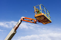 Orange Mechanical Lift, Cherry Picker Royalty Free Stock Images