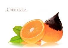 Orange with melting chocolate Stock Photography