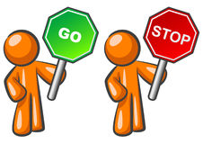Orange men with signs. An illustrated view of two illustrated orange men or cartoon figures, one holding a red stop sign and one holding a green go sign Stock Photography
