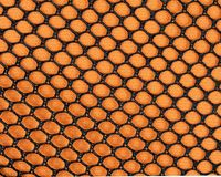 Orange Mesh. Orange and black mesh background Stock Photos