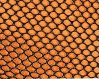 Orange Mesh. Orange and black mesh background stock photos