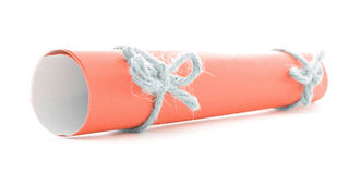 Orange message scroll tied with string, two natural knots isolated. Orange message scroll tied with string, two natural knots, isolated stock photo