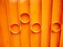 Orange metal fence Stock Photos