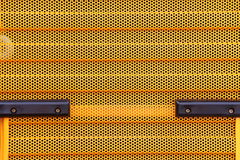 Orange metal grid industrial background Royalty Free Stock Images