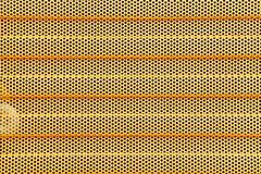 Orange metal grid industrial background Royalty Free Stock Image