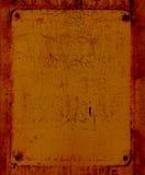 An orange metal grunge texture. Royalty Free Stock Photo