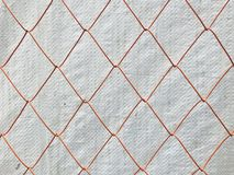 Orange metal mesh with white plastic sheet on background. Using for background royalty free stock photos